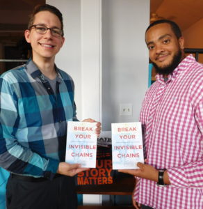 Brandon Telg, left, and Jaron Jones display copies of their self-published book. Photo by Gainesville Downtown)