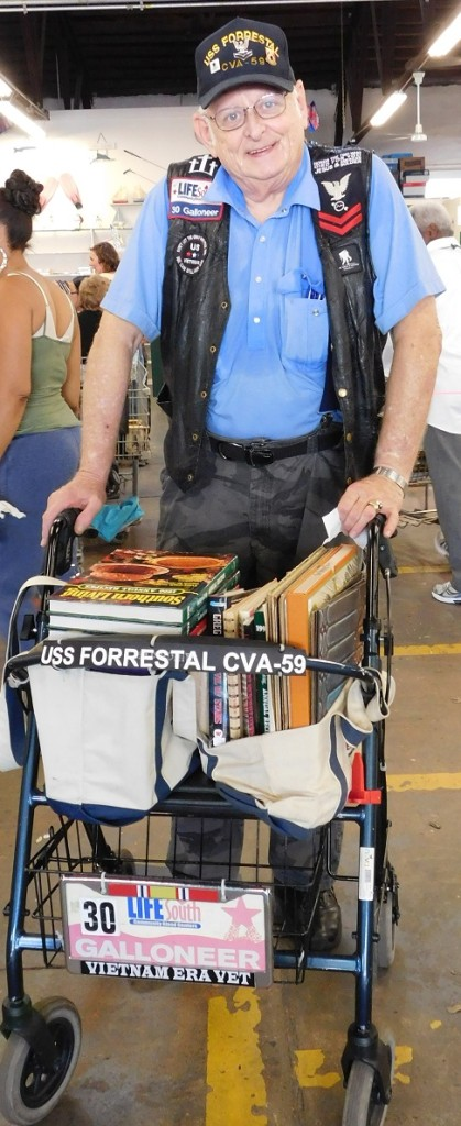 Bob Finley of Gainesville, retired from the Navy and the U.S. Postal Service, wheels his $3.10 worth of books out of the FOL Book Sale on 10-cent day.