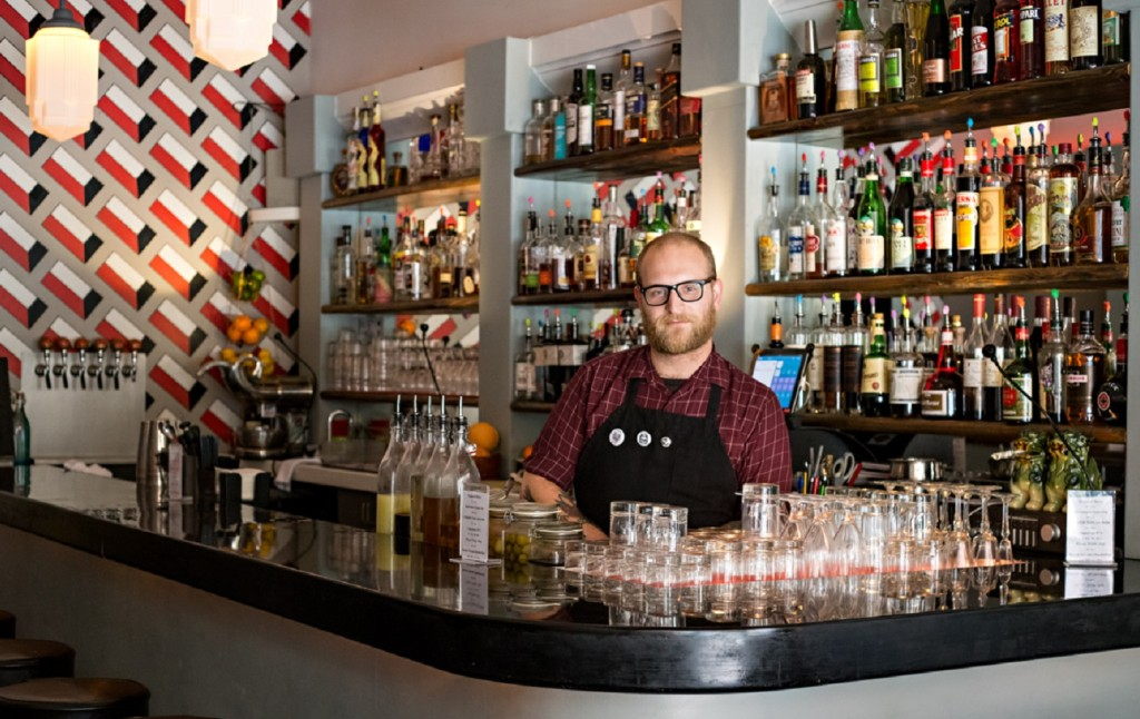 Daniel Schexnaydre behind the bar at The Dime. (Photograph by Lena Crane, Reflections of Light Photography)