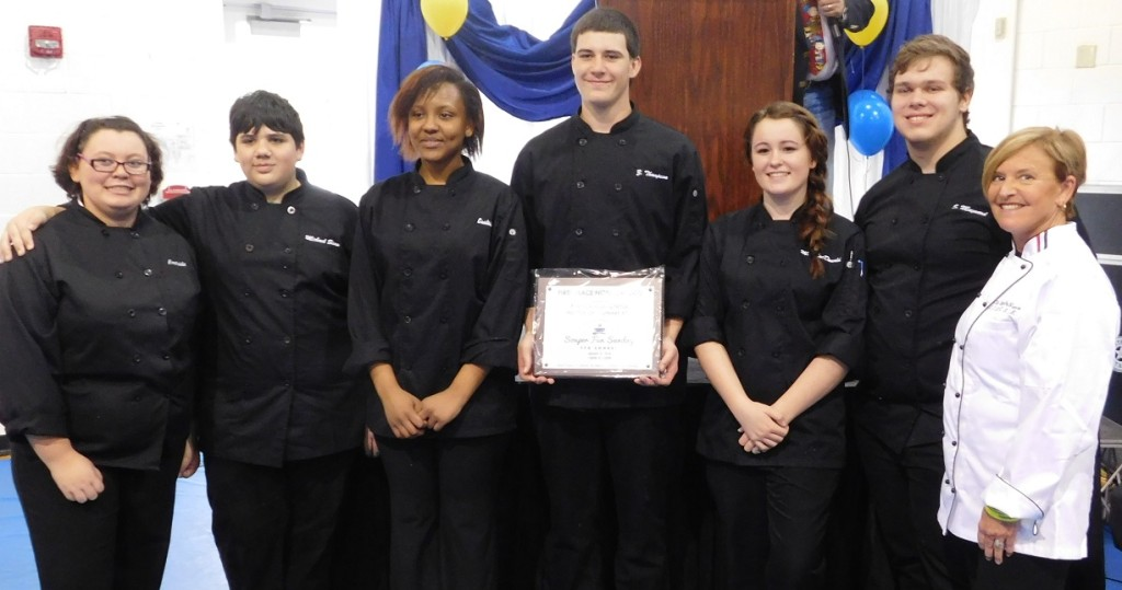 Billie DeNunzio, right, and her award-winning culinary students from Eastside High. Photo by Gainesville Downtown)