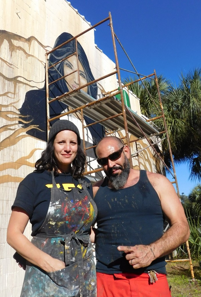 Carrie Wachter Martinez and Jesus Martinez in front of the mural they worked on at High Dive.