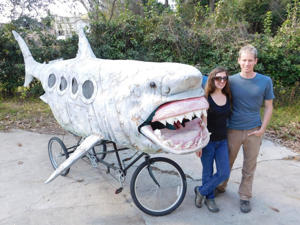 Lorraine Duerden and her husband Raymond Rawls stand in front of the Shark Bike they created. It will be on display tonight at the GRU Warehouse.