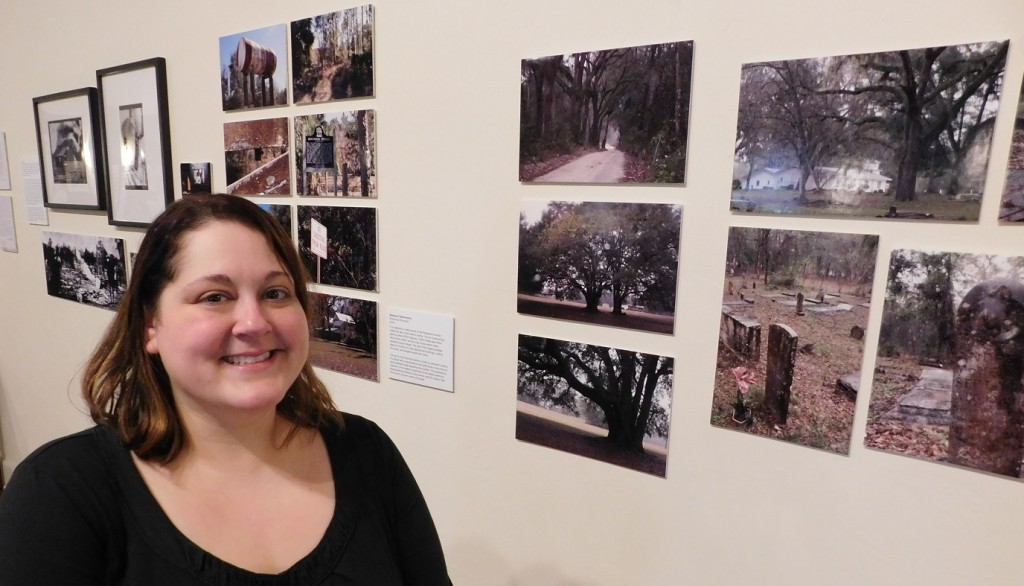 Rebecca Fitzsimmons and some of the photographs she took while researching the Matheson Museum exhibit. Photo by Gainesville Downtown)