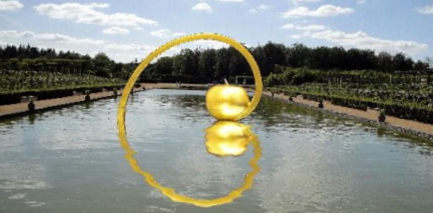 "Marcia Raffs monumental sculpture titled ""Golden Apple/Golden Spiral."""