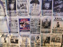 A poster wall draws attention to upcoming events at High Dive.