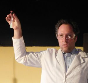 A scientist Adam Lishawa) explains a little something about radium.