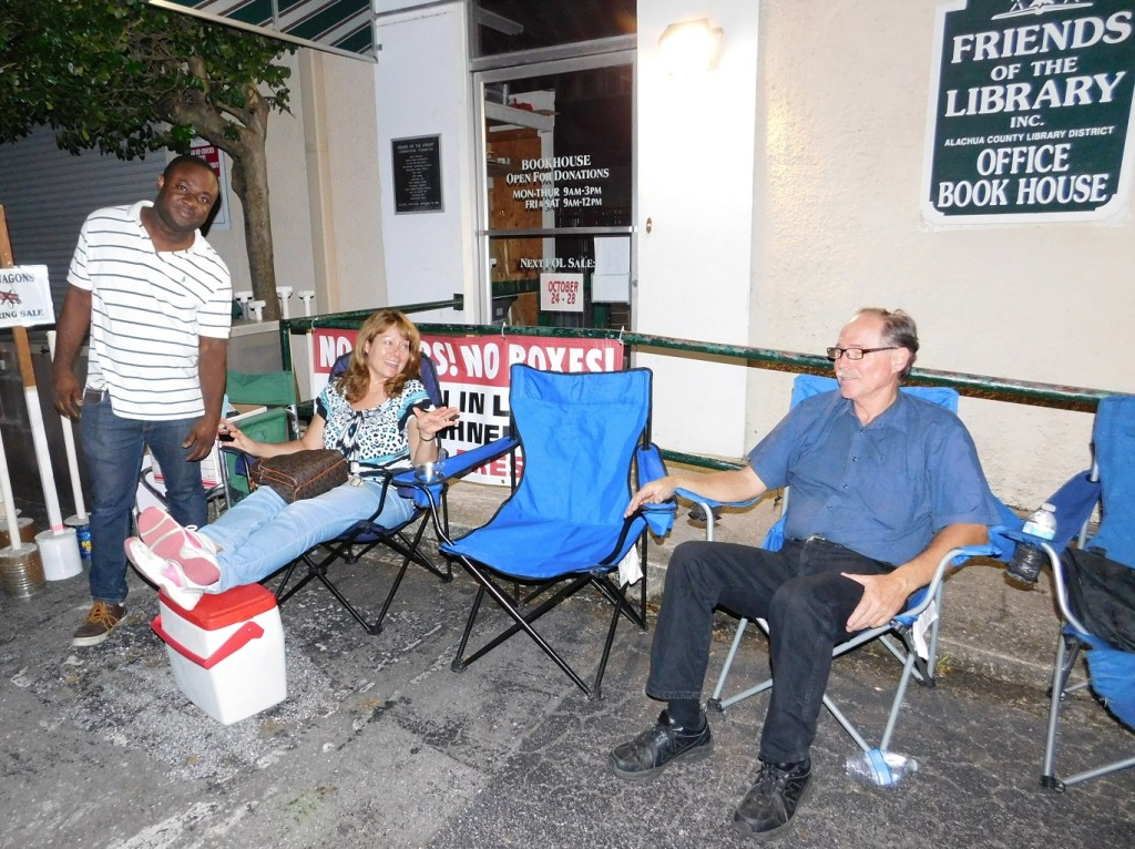 Rod Havens, right, sits with Sharon Kissell and a friend on Friday night outside the Bookhouse.