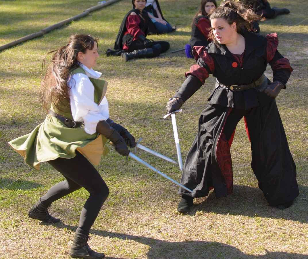 Sunny Andrei, left, displays her combat moves during the Hoggetowne Medieval Faire.