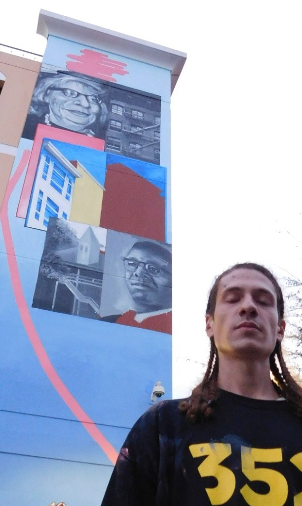 Gaia and his unfinished mural on the Southwest Parking Garage.