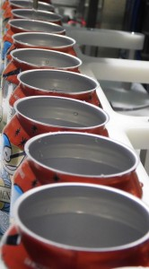 Empty cans line up to be filled with 72 American Pale Ale.