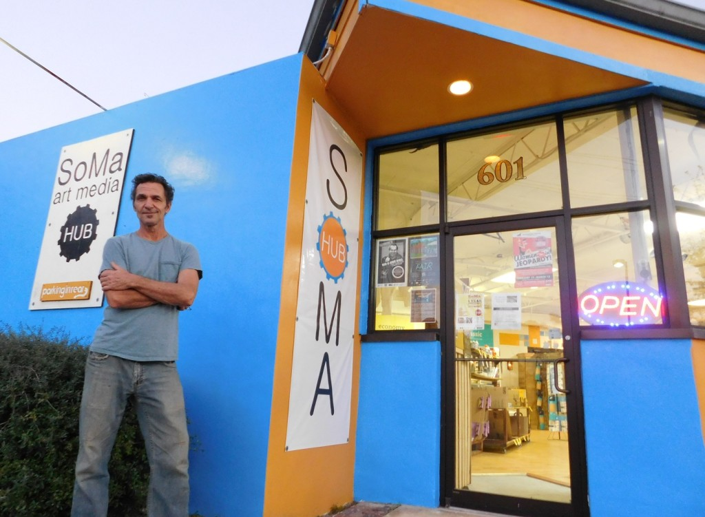 Celino Dimitroff stands in front of the store he co-owns with Charley McWhorter. Photos by Gainesville Downtown