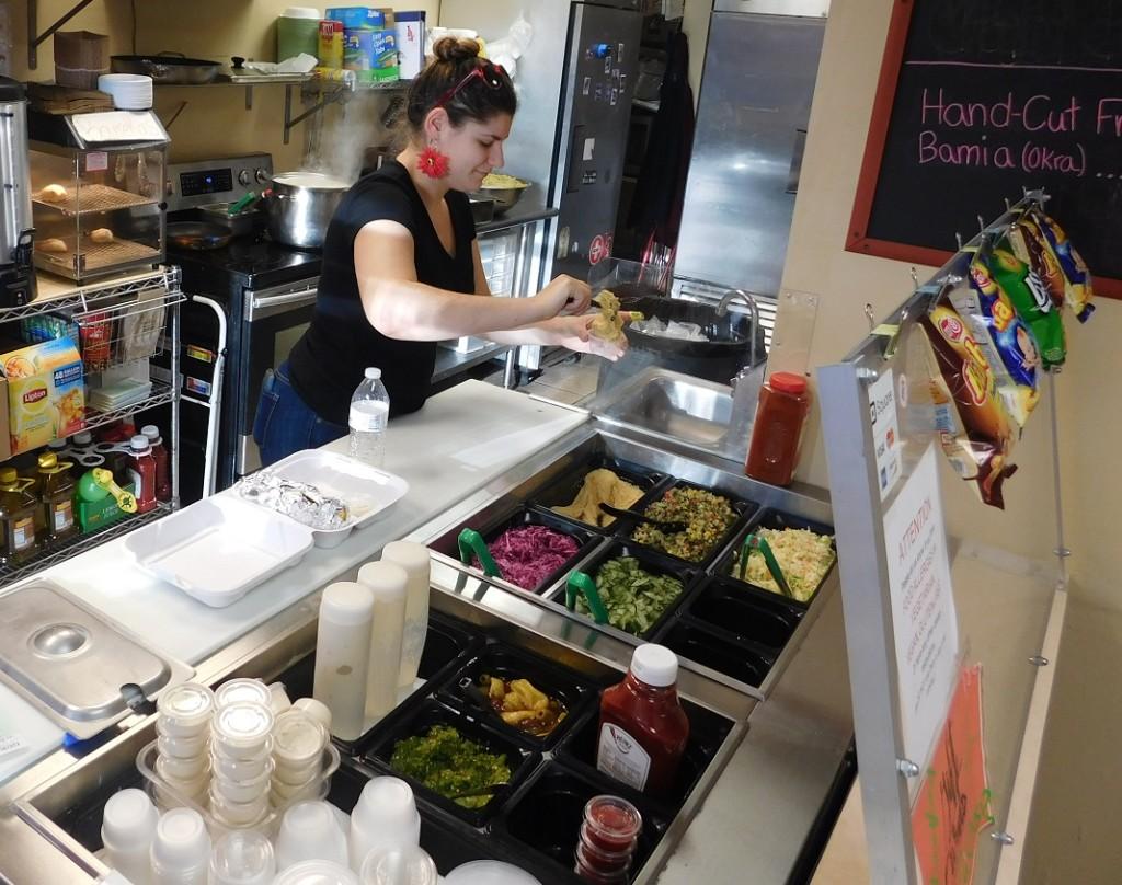 Yael Goldstein fills a customers order at Sababa.