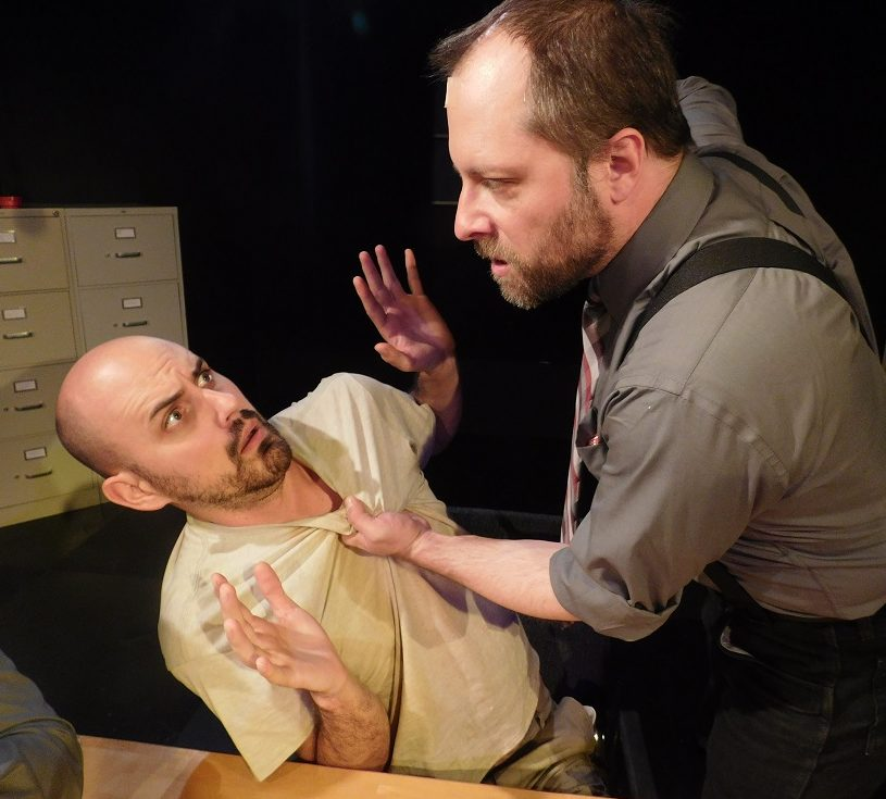 Ariel Adam Lishawa) threatens Katurian Kennan Liston) in a scene from The Pillowman.