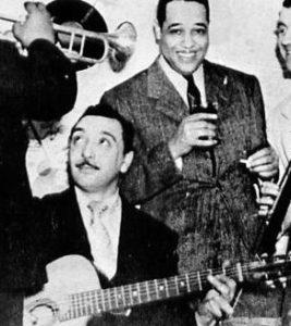 Django Reinhardt displays his two-finger strumming technique with his Quintette du Hot Club du France.