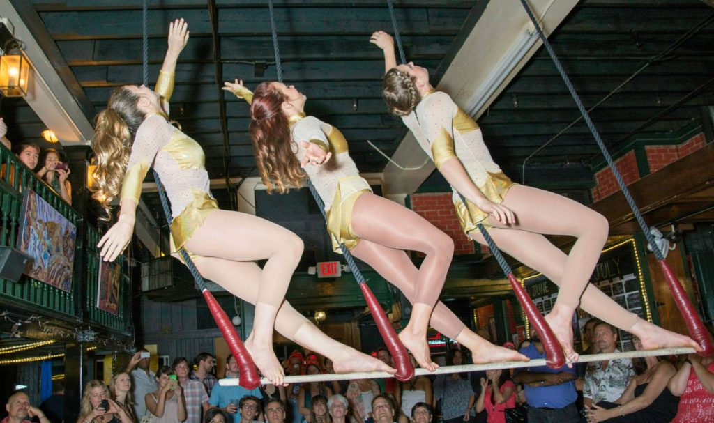 Aerialists for AscenDance perform on the trapeze.