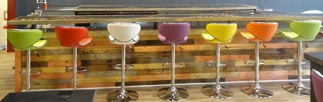 The colorful barstools at Elixir and the wood accents on the bar.