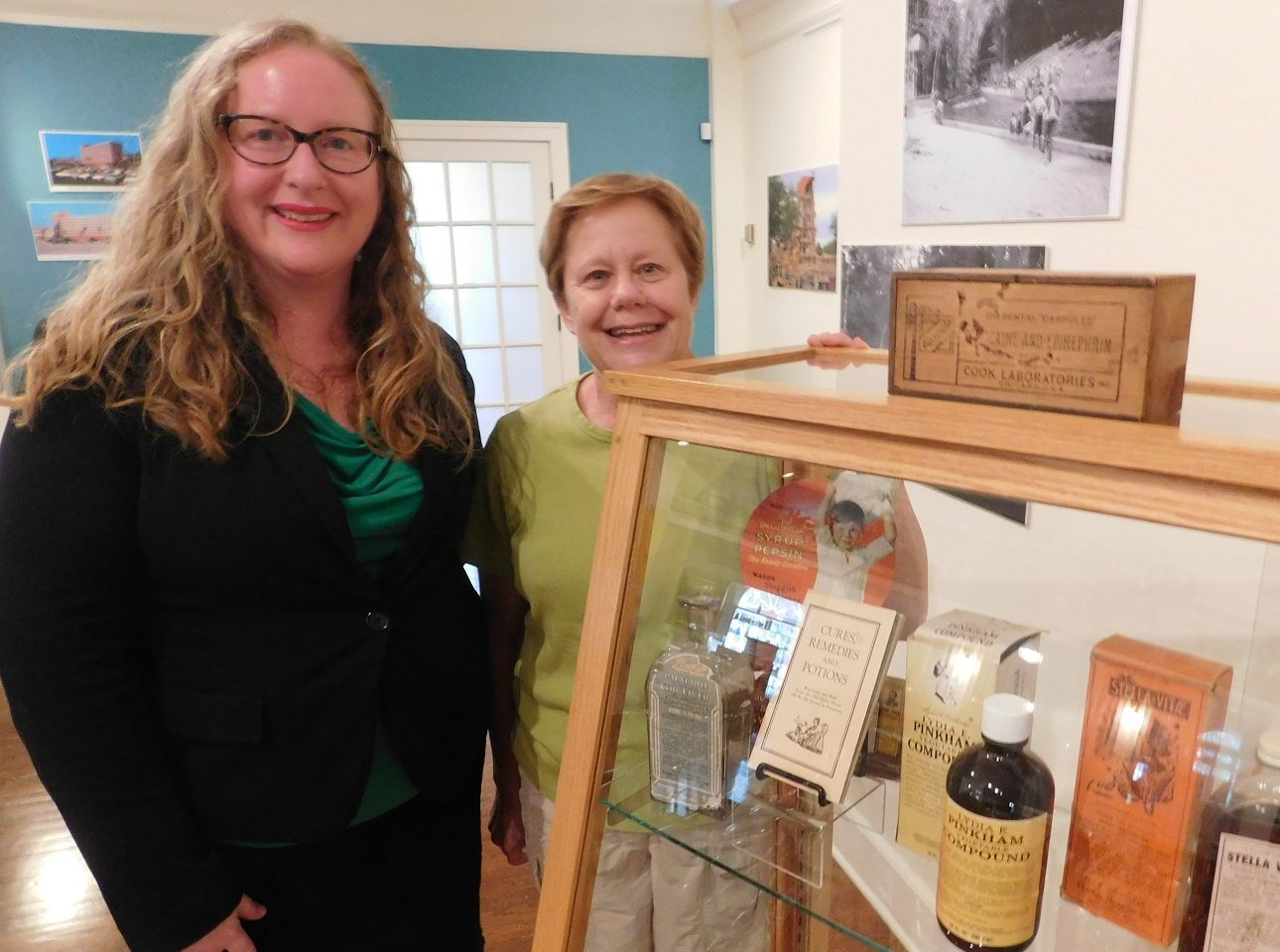 Matheson Museum Executive Director Peggy Macdonald and museum board member Mae Clark in front of a display case that is part of the Medical Milestones exhibit. )Photo by Gainesville Downtown)