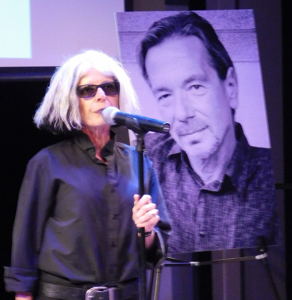 Hippodrome artistic director Lauren Warhol Caldwell shares a story about Rusty Salling. Photo by Gainesville Downtown)