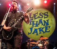 Chris DeMakes performs with Less Than Jake.